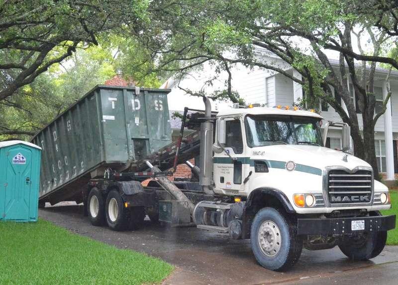 Hauling off dumpster #2.