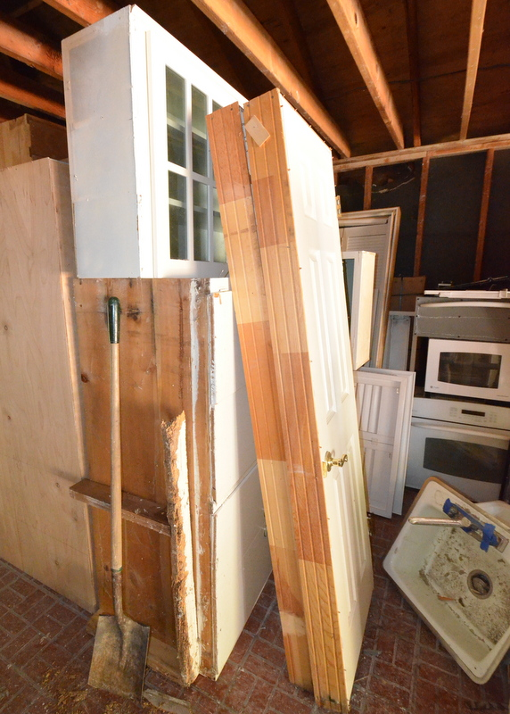 Pre-hung doors and some of the upper and lower cabinets pulled out of the mudroom ...