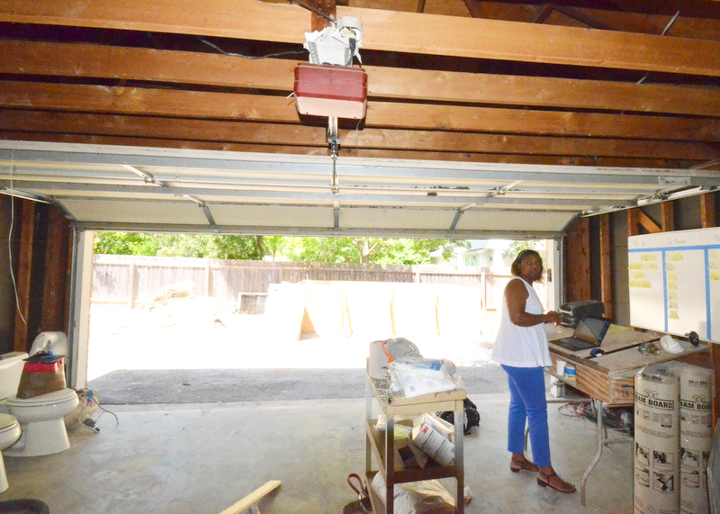 Her Amazing Highness Jacquela in the garage, helping Steven take inventory of donations for Habitat.