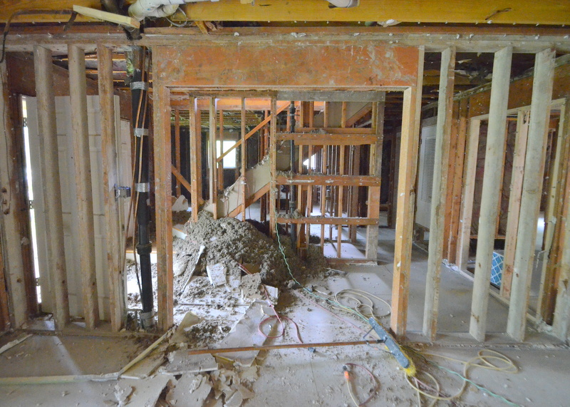 A preview of the demo that is now underway upstairs -- insulation falling to the floor at the stairs and front entry.