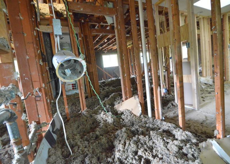 Piles of insulation, wire everywhere, ceiling cans coming down -- demo makes a mess.