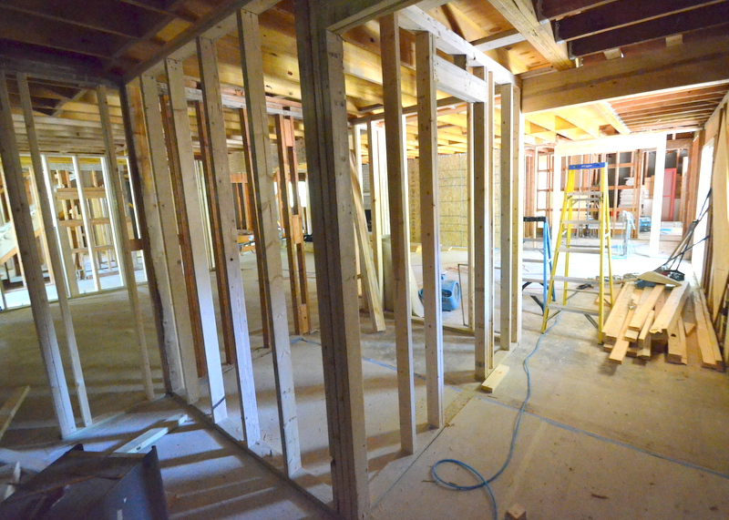 Standing in what will be Steven's office at the front of the house, looking back at the pantry framing and kitchen beyond.