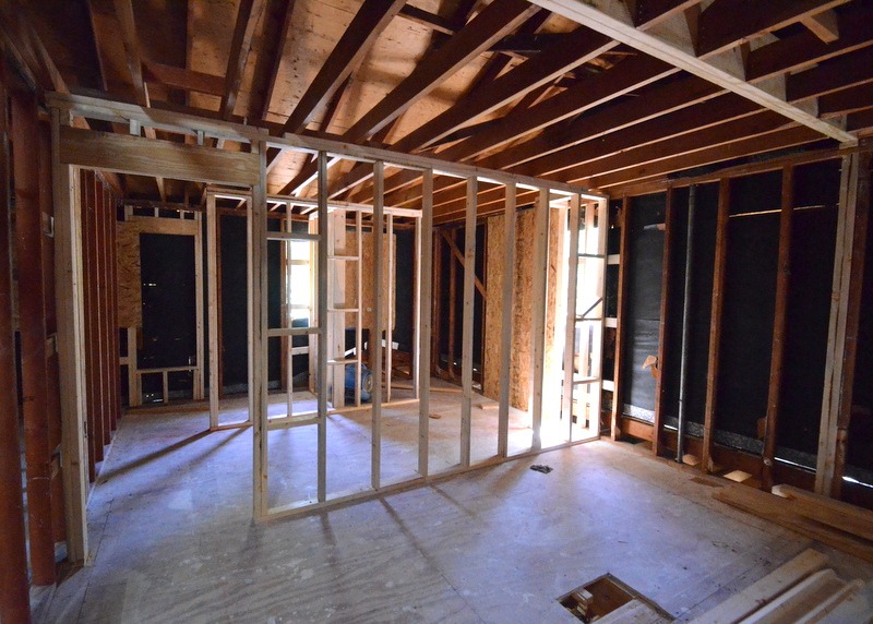 "Moving up to the second floor, this is what is now framed to become the master bath -- shower at left rear, water closet at right rear, with vanity outside the ""wet"" rooms, and a large vertical window to the right."