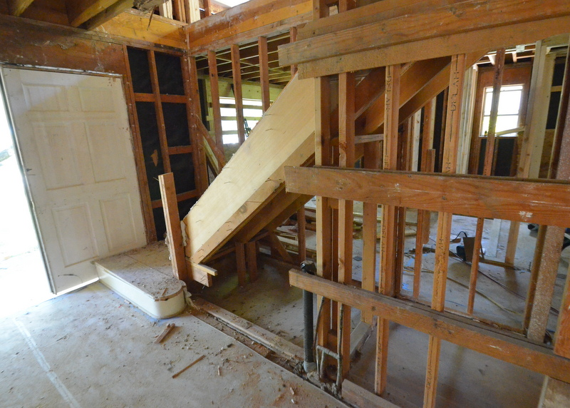 Ron and the framers are beginning to cut away structure from the not-to-code stairs -- scheduled for removal next week, and replacement.