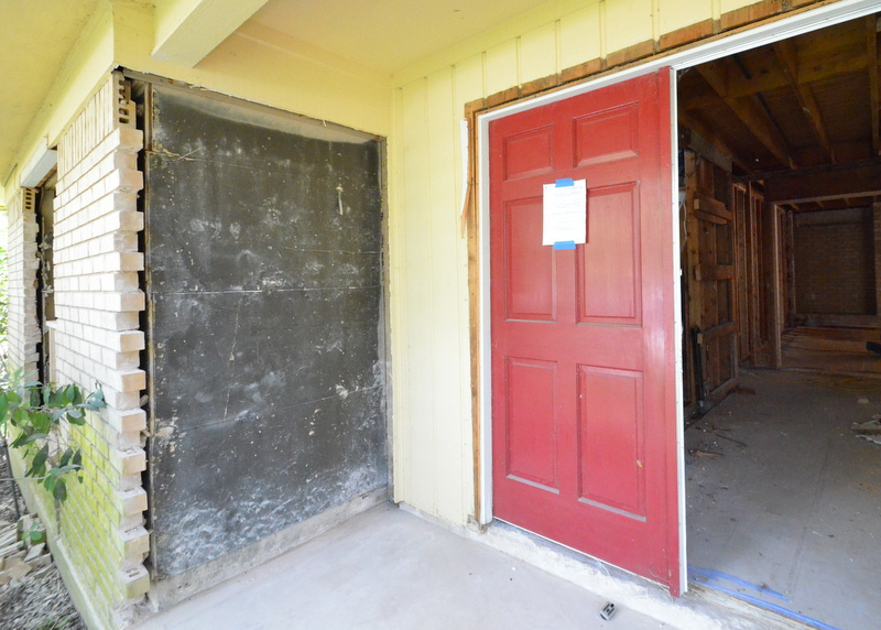 And the brick wing wall to the left of the front door is dismantled.