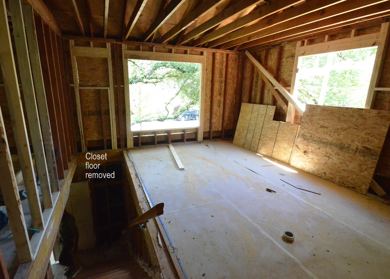 Upstairs, a small section of floor that was a closet is now removed over the stairs. This creates the head room we need to increase the linear run of the stairs into the extension that will added to the front entry -- the extra square footage that is needed to bring the stairs into compliance with code. Plus ... look at that enlarged front window with a treehouse view.