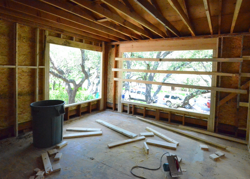 Steven's first look at the view carved by reframing for the new master bedroom windows. One of the best changes we are making to Emerald Hill -- a bedroom that floats in the trees.