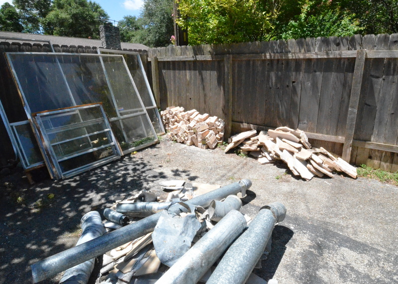 Ranserve is storing the removed brick and stone in the boneyard at the back of the driveway. The brick will be re-used as we remodel the exterior. The fate of the stone is not yet decided.