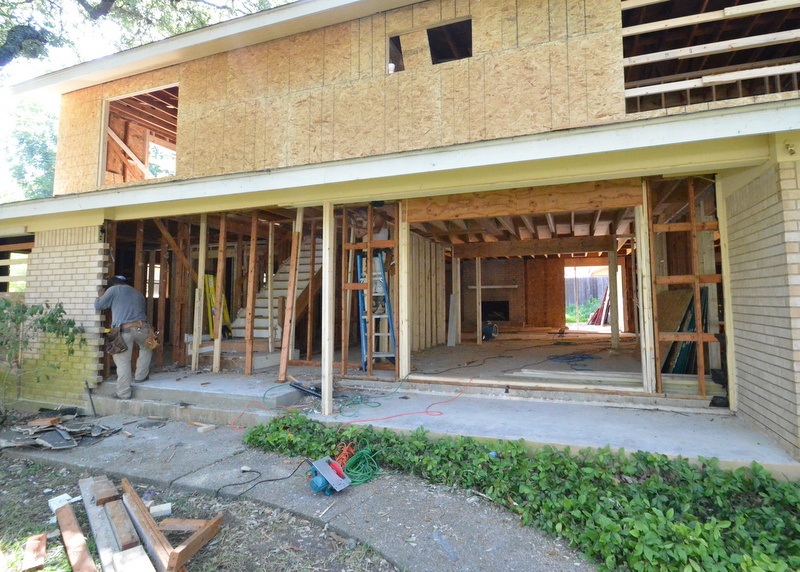 A temporary support holds up the front porch. Temporary supports hold up the second story as new lumber is cut elsewhere for nailing.