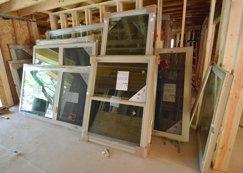 The Milgard windows stacked in what will be the library/dining room.