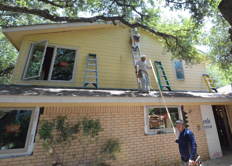 And the framing team is nailing up Hardieboard on the south exterior wall, working in the shade, traveling around the house as the sun moves, avoiding the heat exposure. It's 100 degrees -- hotter on the roof.