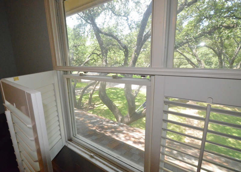 The original shutters and windows, with a glimpse into the trees beyond. Photo shot in August 2014 during the house inspection.