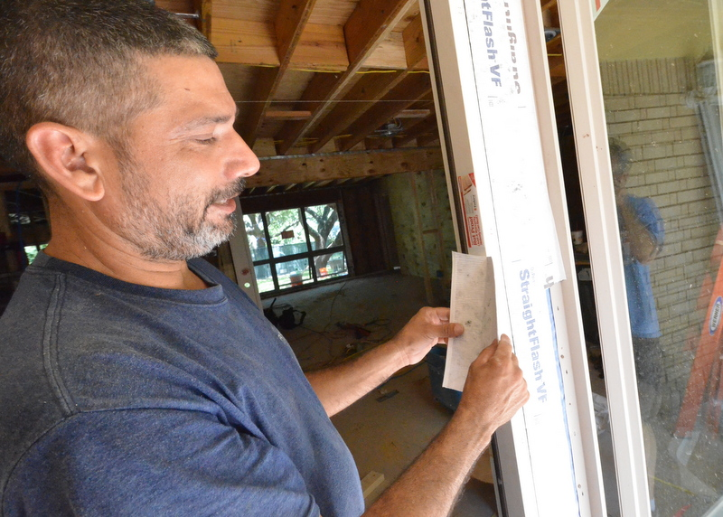 Cris from Ranserve demonstrates how the windows are flashed -- heavyweight peel-and-stick Straightflash VF taped over the window and door flanges, helping to make the window and door watertight.