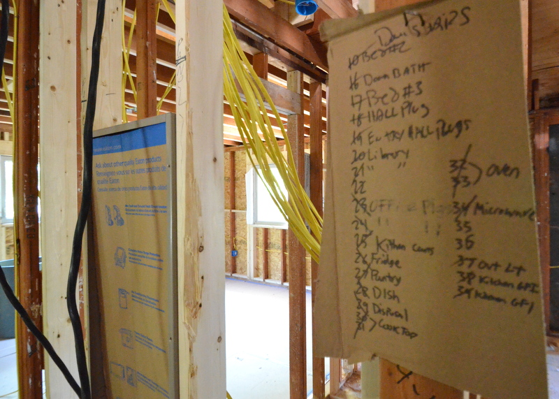 "Capstone Electric hung the service panel in the upstairs closet, with a road map hung nearby identifying which ""home run"" is to be connected to which breaker inside the box."