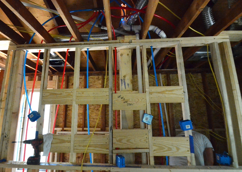 The PEX array at the master bathroom -- red for hot, blue for cold, white for water supplies to toilets. This array will feed two sinks, two shower heads, and a toilet.