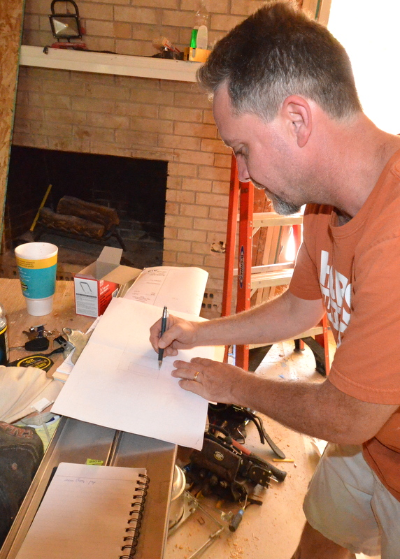Aaron Pratt from Central Texas Custom Cabinets sketches designs for the kitchen cabinets.