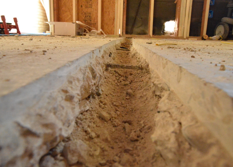 This is the trench carved into the slab by Cris and Kevin -- which the electricians will use to run wire in conduit to outlets mounted in the island.