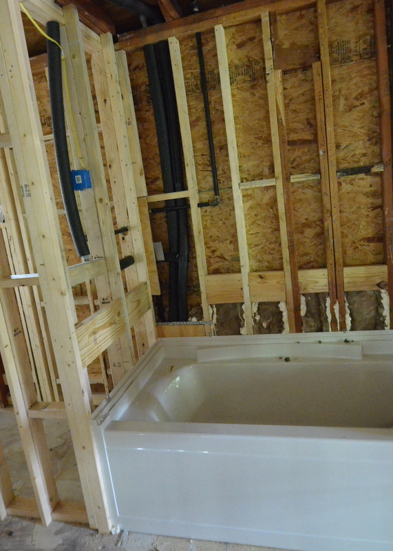 Cris from Ranserve inserted additional framing at the left side of the tub in bath 3, closing up the extra space the tub does not need against the framing.