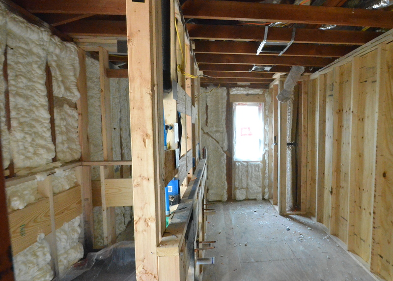 The East and South walls of the master bath, foamed. At right is the wall between the master bath and master closet, with plywood blocking installed to support the shelving and storage that Jacquela plans.