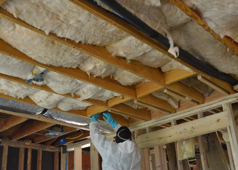About one hour later, most of the ceiling in bedroom 1 is insulated with sound-absorbing batts -- and, already, noise reverberates significantly less.