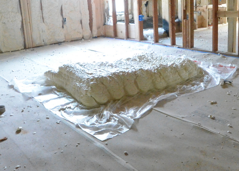 "Ron asked the installers to spray a ""loaf"" of foam against a plastic sheet. Ron will use this to seal any holes he has to make in the house as construction continues after insulation is complete. He will slice out chunks as he needs them. The foam weighs almost nothing. This loaf is probably four feet by eight feet and you can pick it up with one hand."