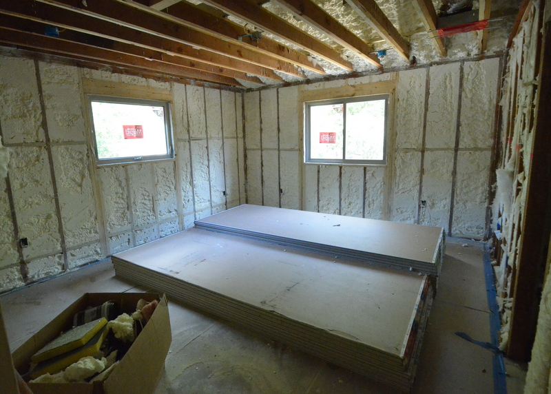 This will be bedroom 3, also known as the model train room. Drywall delivered and stacked for installation. Foam sprayed into the stud bays on the exterior walls and the underside of the roof.