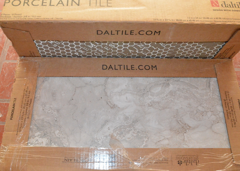 This is a box of tile for the floor in bath 2 and bath 3.
