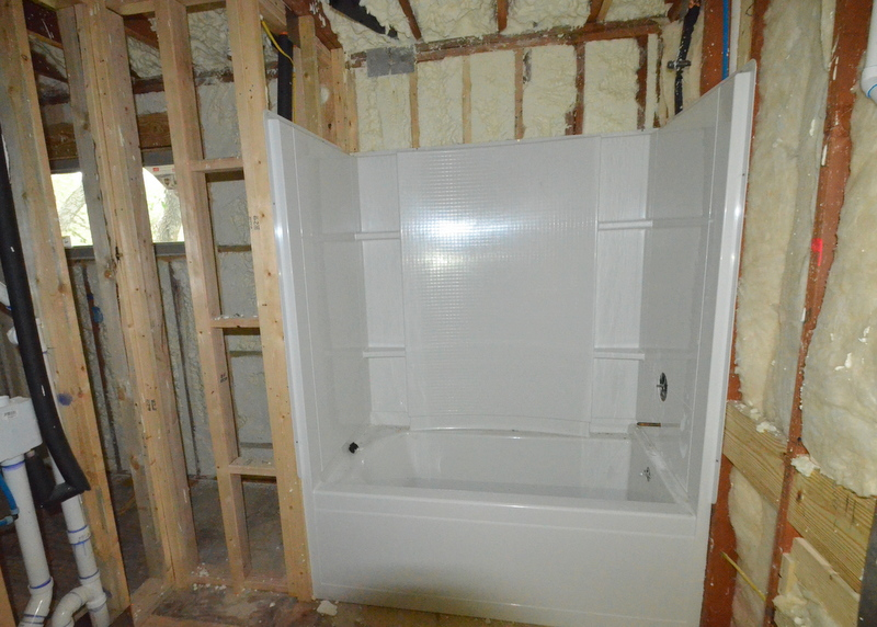 Upstairs in bath 3, the left and right and back walls of the shower/tub are installed.