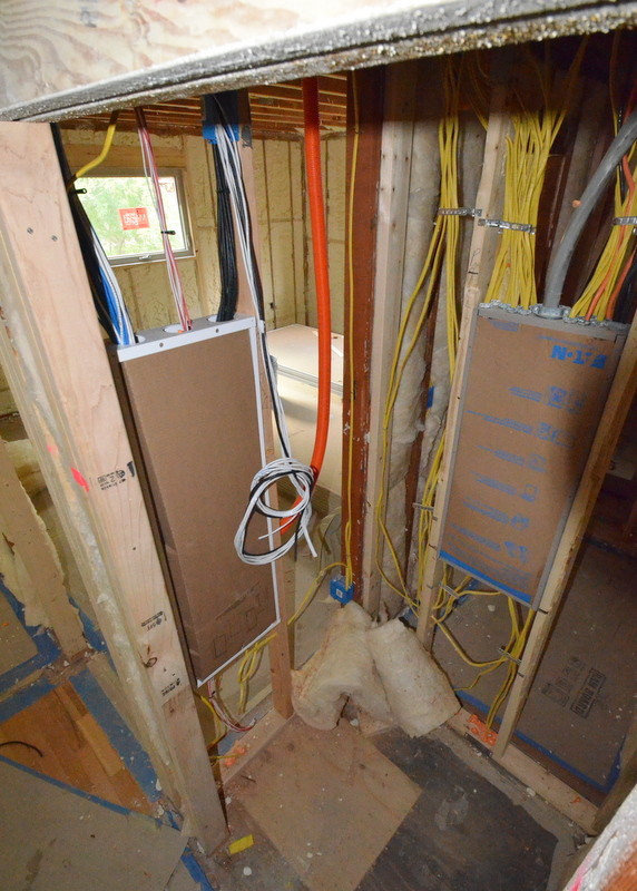 The other end of the pull conduit hanging next to the distribution box in the electrical closet.