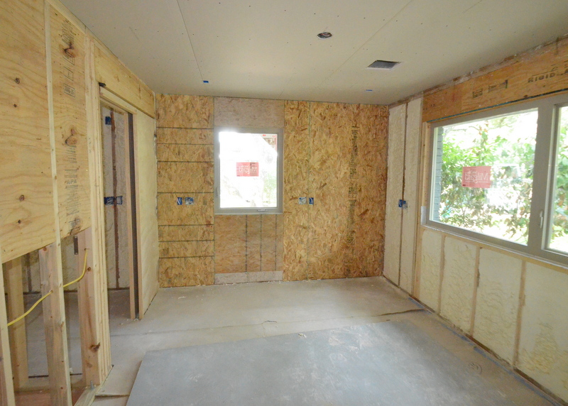 Downstairs in the office, Ron hung OSB sheathing to serve as blocking for the shelves that Steven plans for the south wall. Drywall will go over the sheathing, and the OSB will provide structural support when Steven hangs shelving.