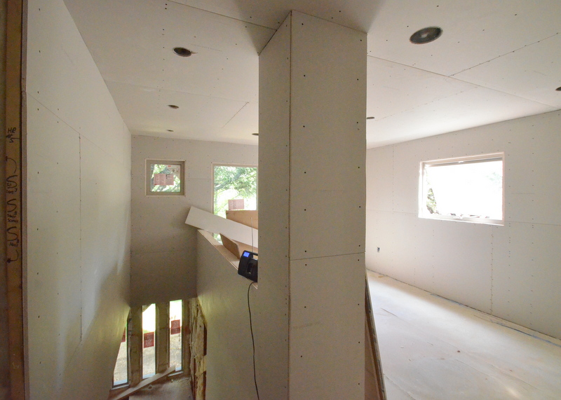 The stairwell and loft, drywall hung.