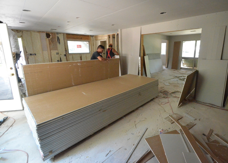 turning 180 degrees in the family room to look at the kitchen drywall going up.