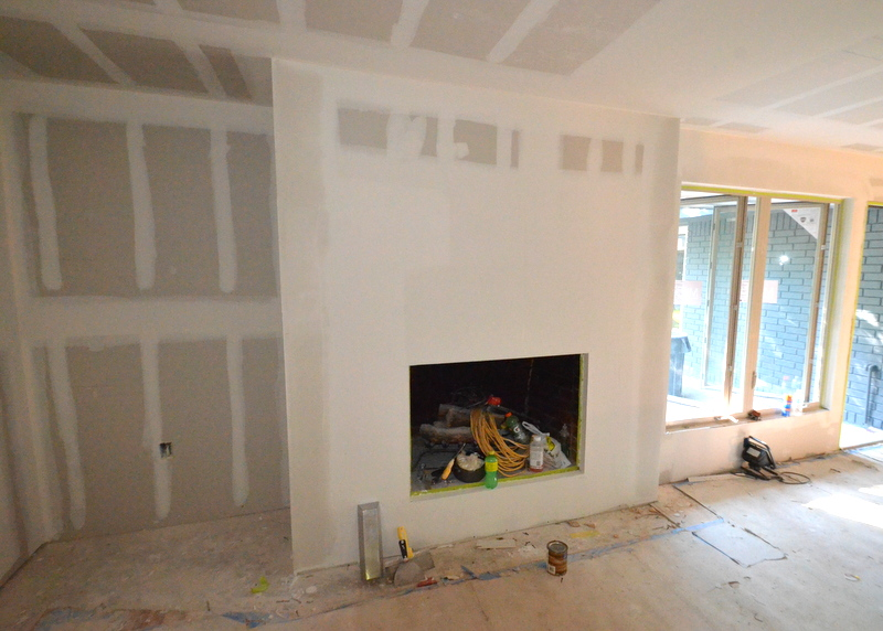 By Thursday, 1 October, the hated yellow brick of the fireplace is gone, hidden behind clean, simple, fire-resistant drywall. A blank canvas to be painted.