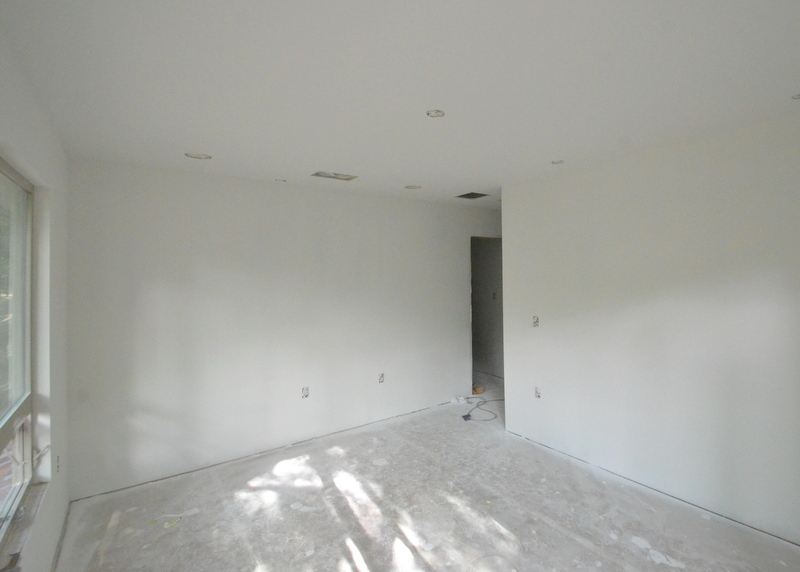 The master bedroom, made into a white slate by primer.