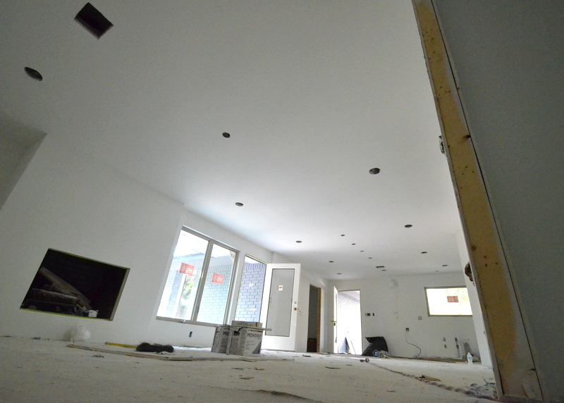 The walls and ceiling of the great room downstairs -- kitchen and family rooms integrated into one space, primered ...