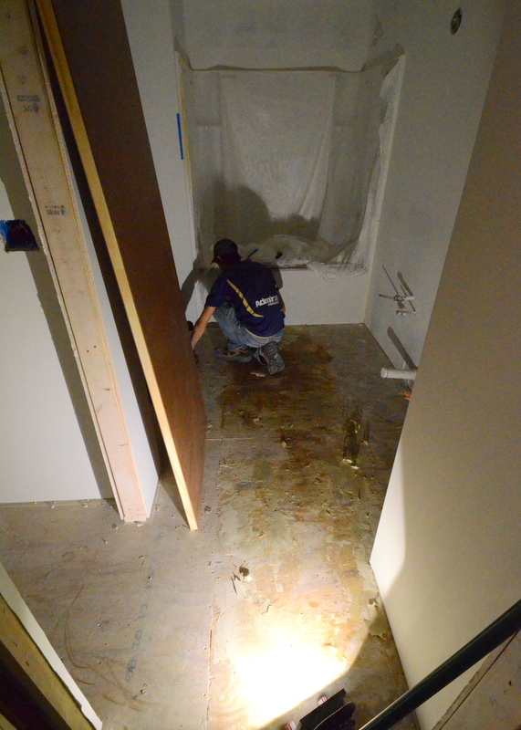 Kevin Rehberg chips away at the last of the original linoleum and glue in bath 3 upstairs, prepping the room for tile. This may be the last demo we need to do inside the house at Emerald Hill. Milestone.