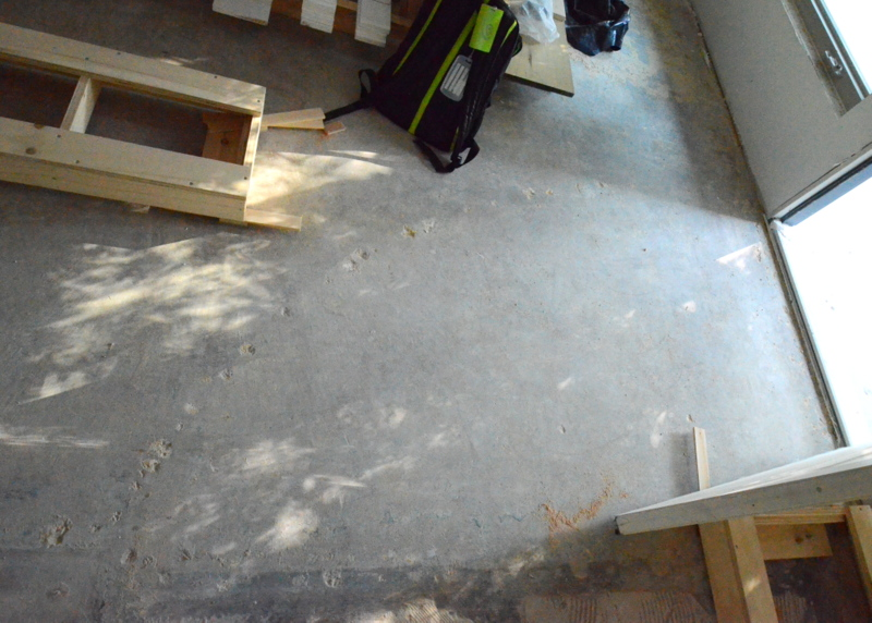More history uncovered and discovered. At some point, the family room at Emerald Hill was carpeted -- and an arc of some other flooring was installed at the back door. Look closely at the gray concrete for the clefts hollowed out in the slab by the nails in the carpet tack.
