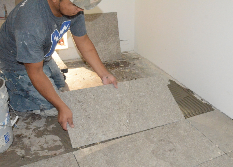 And sets a tile into place.