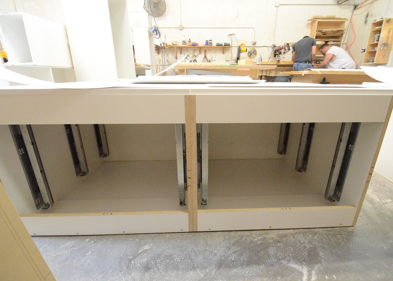 Peering into the same cabinets for what would be a top-down view of the drawer slides, already mounted.