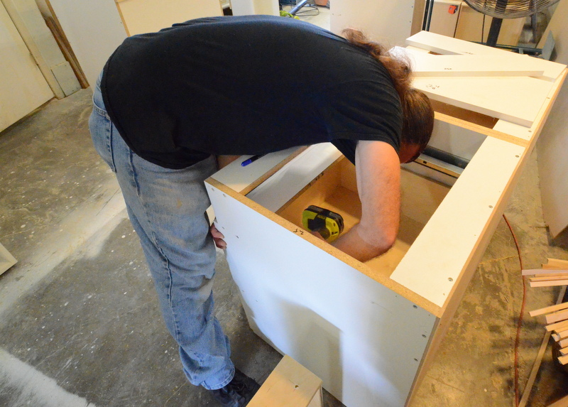 Chris begins to install a drawer front ...