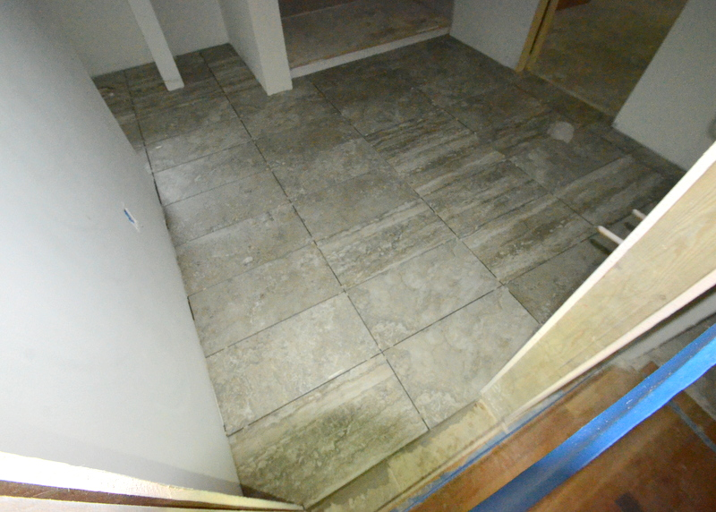 Pedro yesterday started and completed the tile floor in bath 2, Jadin's bath.