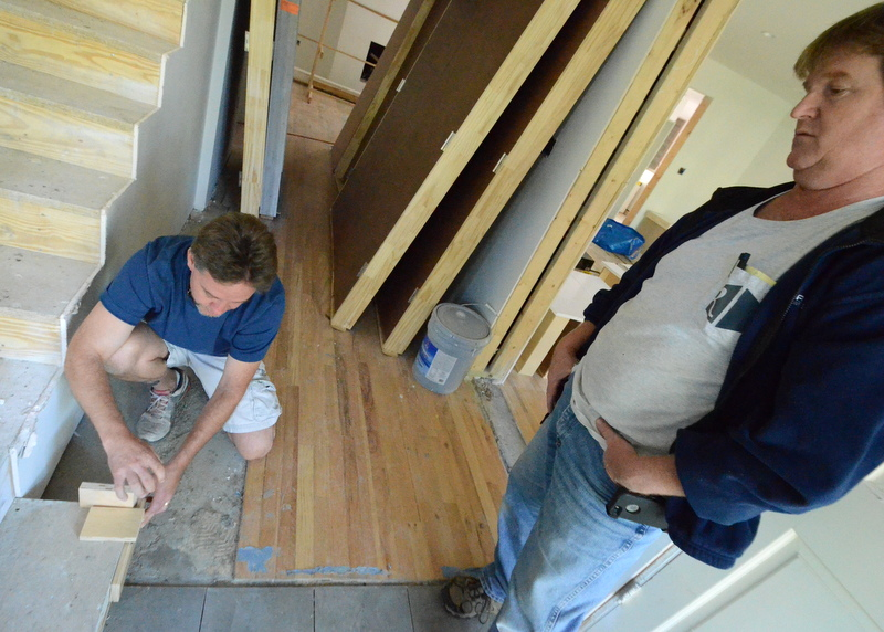 In the entry hall, Aaron and Ron plot how the stairs will meet the low bench at the stair landing. The bench will include storage for shoes, bags, books and other items -- an arrangement suggested by homes in Japan that Jacquela, Jadin and Steven visited.