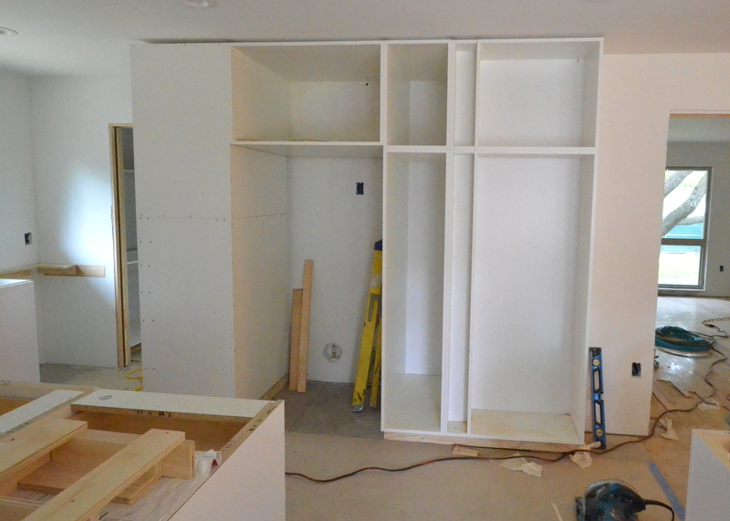 ... and assembling the bank of utility cabinets to the right of where the refrigerator will slide against the wall.