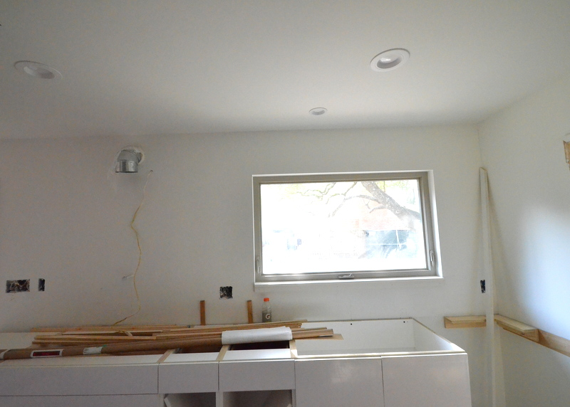 The electricians have been back, installing outlets upstairs. And the final LED light directly above the kitchen sink -- the smaller 4-inch fixture closest to the window, not the 6-inch fixture closer to the camera lens.