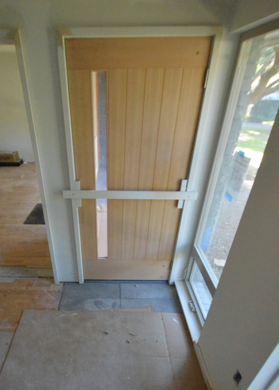 Julian and his team of tilers installed the last two tiles at the front door -- the two tiles closest to the door.