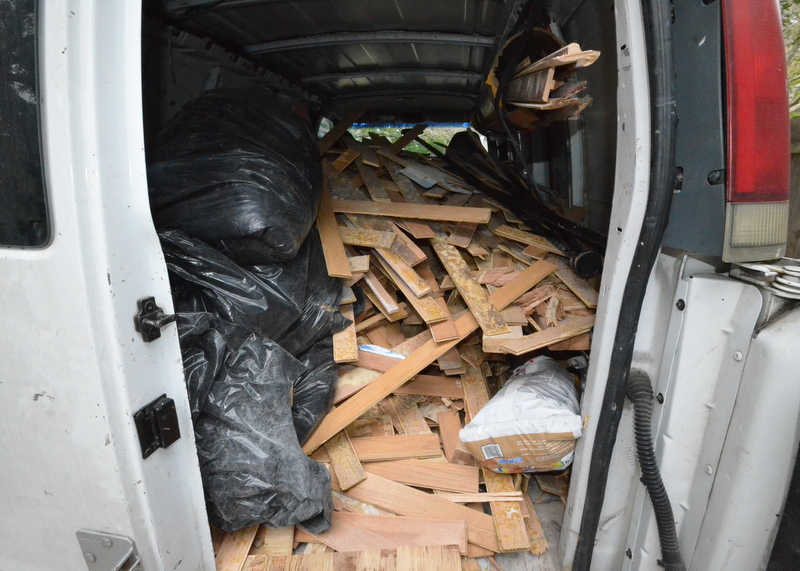 Ron says it took Ivan and his army 10 minutes to remove what remained of the existing oak flooring. Ivan says it took 30 minutes to remove the glue. Here is most of it, loaded into a van for recycling.