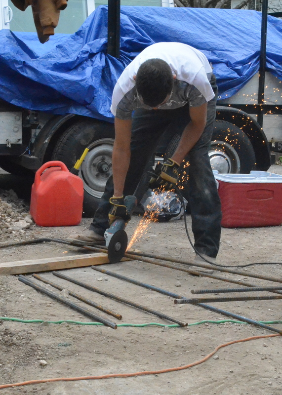Ely cuts rebar to length. Sparks fly.
