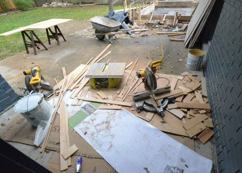 The woodshop that the Army of Landers is using to cut lumber -- two sliding miter saws and one portable table saw.
