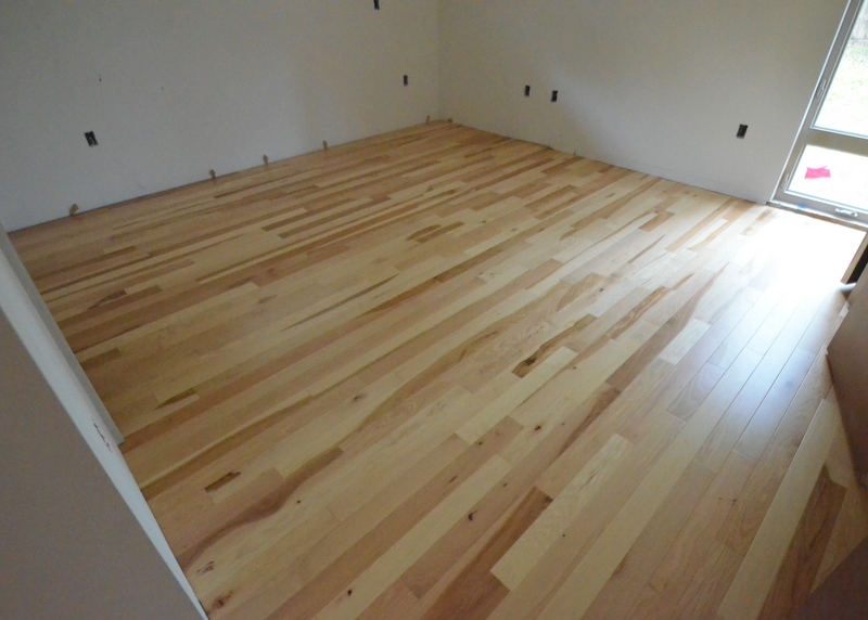 The hickory floor is finished in what will be Jadin's bedroom.
