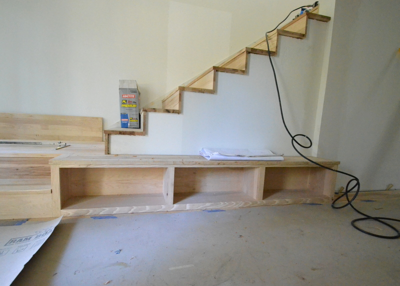While Luis worked on the stairs, Cris from Ranserve mounted this storage unit into position next to the stairs, then trimmed the face with hickory. The idea for this adapts from the Japanese Genken -- the entry hall where everyone removes their shoes before actually walking further into the house.
